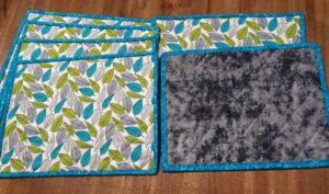 Every Day placemats with leaves with Teal Binding