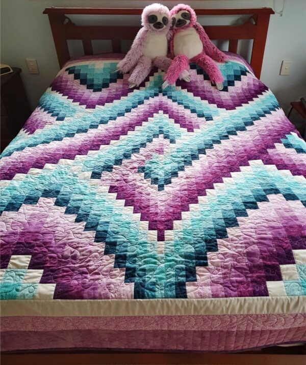 Quilt in mauve and teal