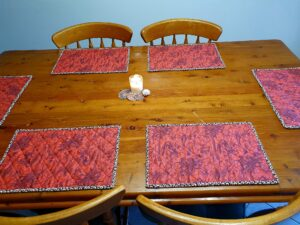 Reversible Placemats Black, Red and Bone.